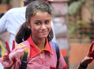 playful holi smile girl