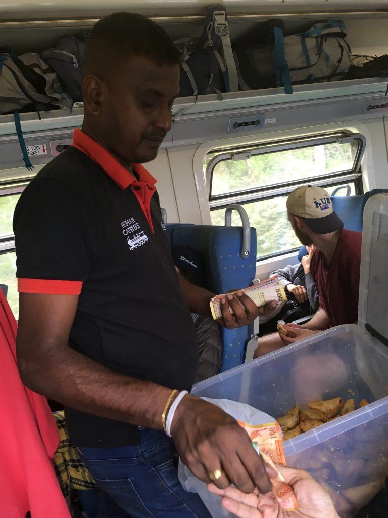 Man Selling Food On Train